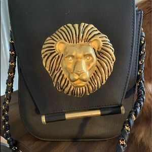 Handbags - Nima Black purse /lion head and rhinestone eyes.